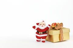Santa Claus and Christmas gift box. On white background Stock Photos
