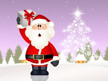 Santa Claus with Christmas gift Royalty Free Stock Image