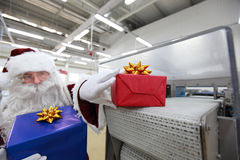 Santa claus & christmas gift machine Stock Photo