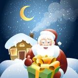 Santa Claus with Christmas gift Stock Photo