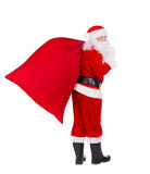 Santa Claus with Christmas gifts bag isolated on white backgroun. Santa Claus with huge red Christmas bag full of gifts coming to present it for children Stock Photos