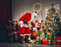 Santa Claus with christmas gifts Stock Photo