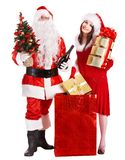 Santa Claus and Christmas girl. Santa Claus and Christmas girl with shopping bag. Isolated Stock Photography