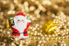 Santa claus, christmas. Santa  golden background, glitter bokeh Stock Photo