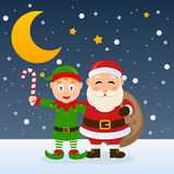 Santa Claus and Christmas Green Elf. Santa Claus holding the sack of the gifts and a cute Christmas elf holding a candy cane, in a snowy scene with the moon and vector illustration
