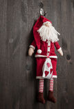 Santa Claus Christmas handmade toy. Hand made textile Santa Claus Christmas decoration. Christmas toy. Vintage style, over wood background Royalty Free Stock Image