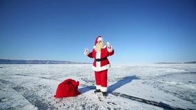 Santa Claus. Christmas holidays, Santa Claus walks around the lake Baikal, Siberia stock video