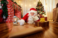 Santa Claus at Christmas, New Year's Eve wrote a list of gifts t Stock Photography