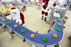 santa claus at christmas ornament production line  Stock Images