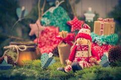 Santa Claus Christmas ornaments green pine needles cones gifts Royalty Free Stock Image