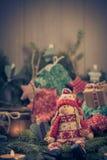 Santa Claus Christmas ornaments green pine needles cones gifts Royalty Free Stock Photo