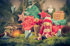Santa Claus Christmas ornaments green pine needles cones gifts Stock Images