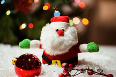 Santa claus and christmas ornaments on snow Stock Photo