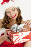 Santa Claus with Christmas present Royalty Free Stock Photos