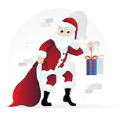 Santa Claus with Christmas present Stock Photo