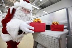 Santa claus & christmas presents machine Stock Images