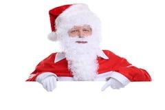 Santa Claus Christmas que muestra la bandera vacía con el copyspace foto de archivo