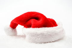 Santa claus christmas red cap with white collar on snow Stock Image