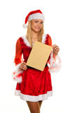 Santa Claus at Christmas with request letter. Royalty Free Stock Photo
