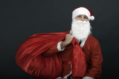 Santa Claus with christmas sack Stock Images