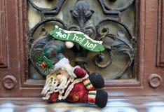 Santa Claus Christmas toy. Entrance decoration - Santa Claus Christmas toy at door Stock Photo