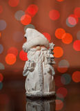 Santa Claus - a Christmas toy on a fir-tree Stock Photos