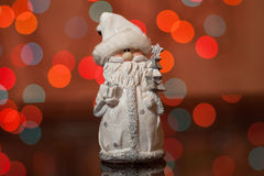 Santa Claus - a Christmas toy on a fir-tree Royalty Free Stock Image