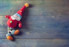 Funny Santa Claus - Christmas toy on the wooden background Royalty Free Stock Image