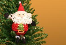 Santa Claus in a Christmas tree Royalty Free Stock Image