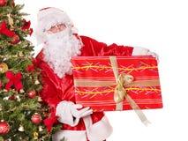 Santa claus by christmas tree. Royalty Free Stock Photo
