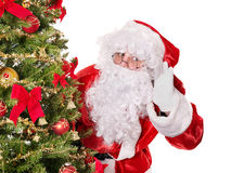 Santa claus by christmas tree. Royalty Free Stock Photos