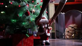 Santa Claus beside a  Christmas tree stock video footage