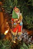 Santa Claus. A Santa Claus in a Christmas tree Royalty Free Stock Images