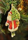 Santa Claus. A Santa Claus in a Christmas tree Stock Photos
