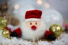 Santa Claus with Christmas tree balls and snow Royalty Free Stock Photo