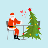 Santa Claus and Christmas tree in cafe. Christmas dinner. Old ma Royalty Free Stock Photography