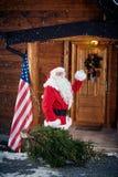 Santa Claus with Christmas tree -Christmas, holidays and people Stock Photos