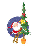 Santa Claus and Christmas tree. Santa Claus decorates a Christmas tree Stock Photo