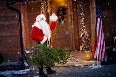 Santa Claus with Christmas tree Stock Image