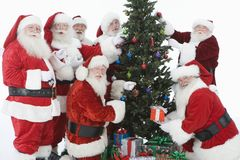 Santa Claus With Christmas Tree And Gifts Royalty Free Stock Photos