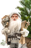 Santa Claus with christmas tree and gifts Royalty Free Stock Photography