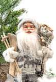 Santa Claus with christmas tree and gifts Stock Image