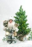 Santa Claus Christmas tree Gifts snow Winter holidays decoration Stock Photos