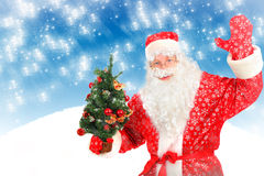 Santa Claus with Christmas Tree Stock Photography