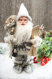Santa Claus with christmas tree in snow Royalty Free Stock Photography