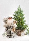 Santa Claus with christmas tree in snow Royalty Free Stock Image