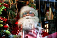 Santa Claus, Christmas tree and toys at a Christmas souvenir mar Royalty Free Stock Photos