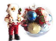 Santa Claus and Christmas tree toys in a round glass vase. Santa Claus and the Christmas tree toys in a round glass vase stock photo