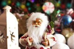 Santa Claus and Christmas tree toys in a round glass vase Royalty Free Stock Images