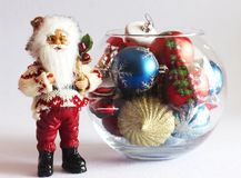 Santa Claus and Christmas tree toys in a round glass vase Stock Images
